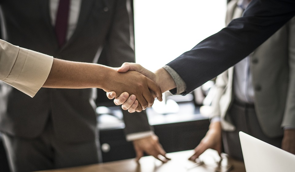 Hire the Right People handshake with applicant and employer USA PostImage - 5 Ways to Jumpstart Your Childcare Service in the US