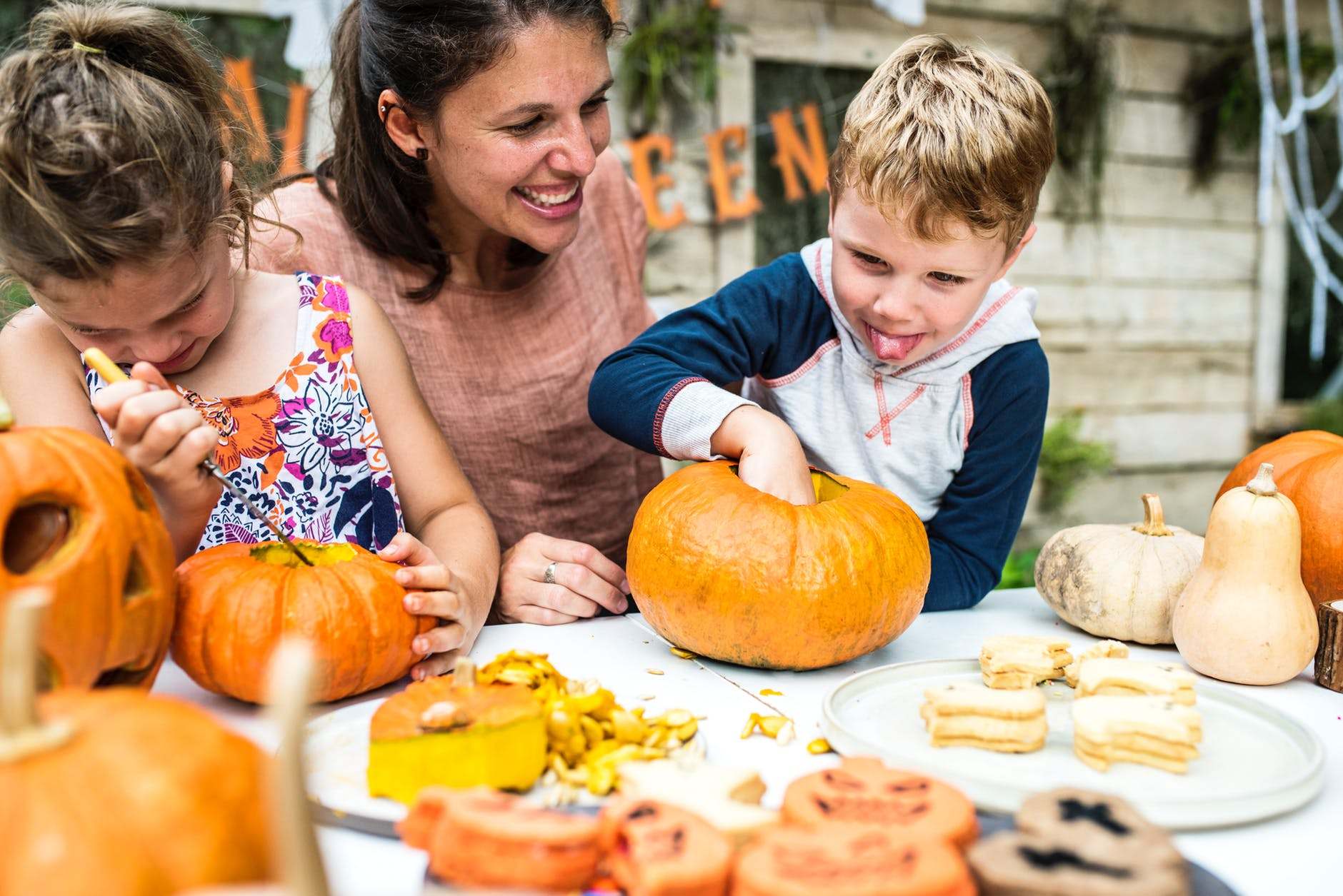 Help Others mother having fun wih kids on making halloween pumpkin USA Postimage - 3 Incredible Tips for Successful Childcare Service in the US